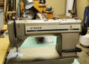 Singer 591 straight stitch industrial sewing machine.  Call 902 543 8593 for more information..
